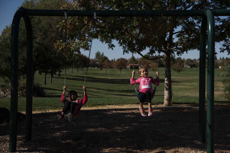 kids on swings - documentary family photography