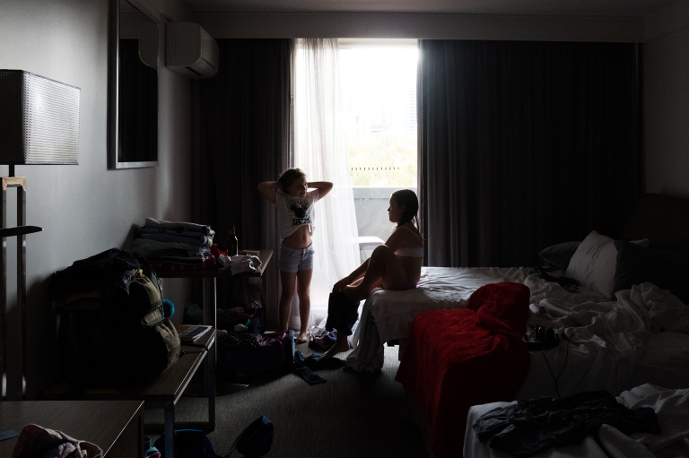 kids at hotel room window -documentary family photography