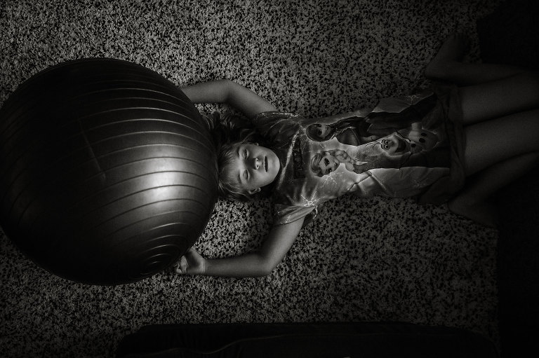 girl with exercise ball - documentary family photography