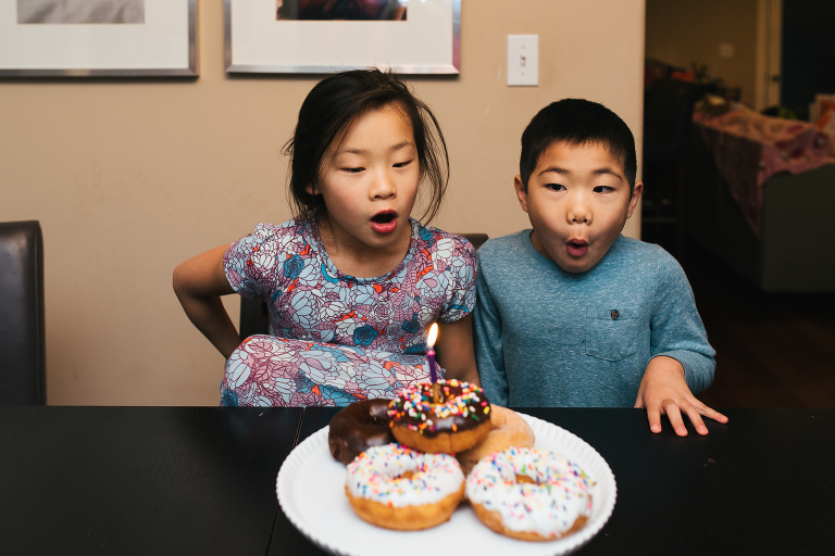 kids with birthday doughnuts - documentary family photography