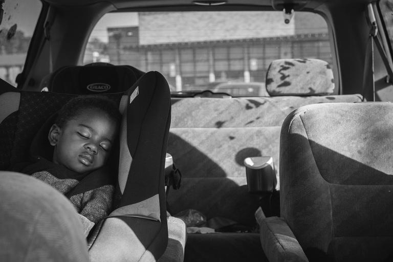 boy asleep in car seat - Documentary Family Photography