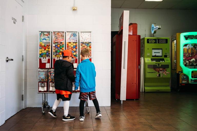 boys at vending machine - Documentary Family Photography