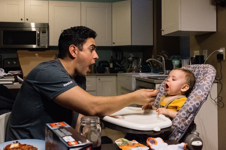 Father feeds baby - Documentary Family Photography