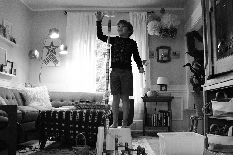 boy with marble tower - Documentary Family Photography