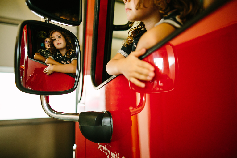 girl in fire truck - Documentary Family Photography