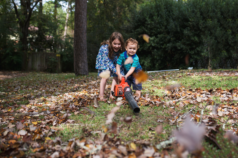kids with leaf blower - Documentary Family Photography