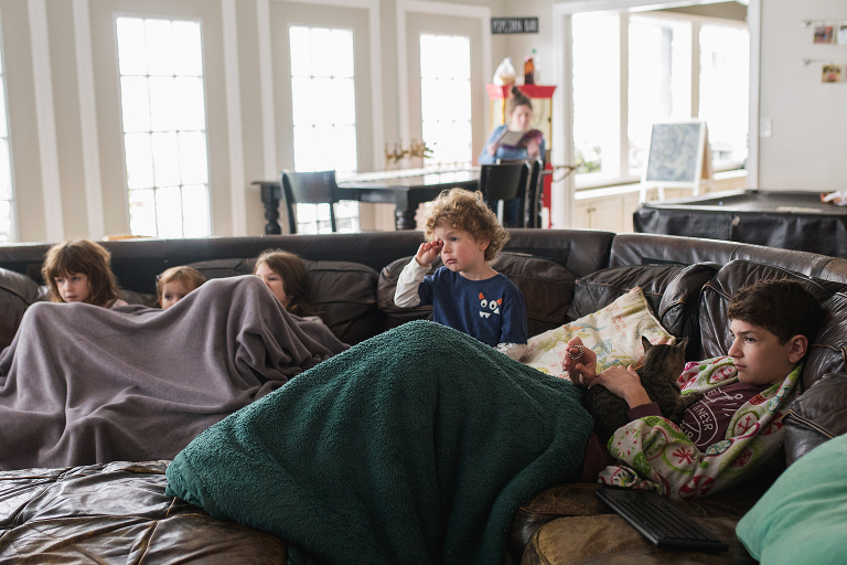 kids cuddled on couch - documentary family photography