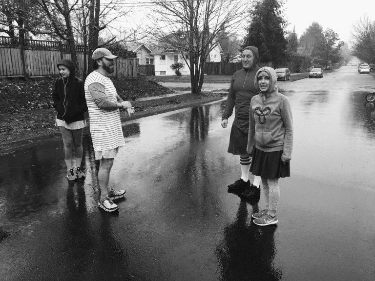 family on rainy street - documentary family photography