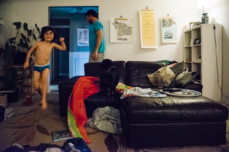 kid jumping off couch - documentary family photography