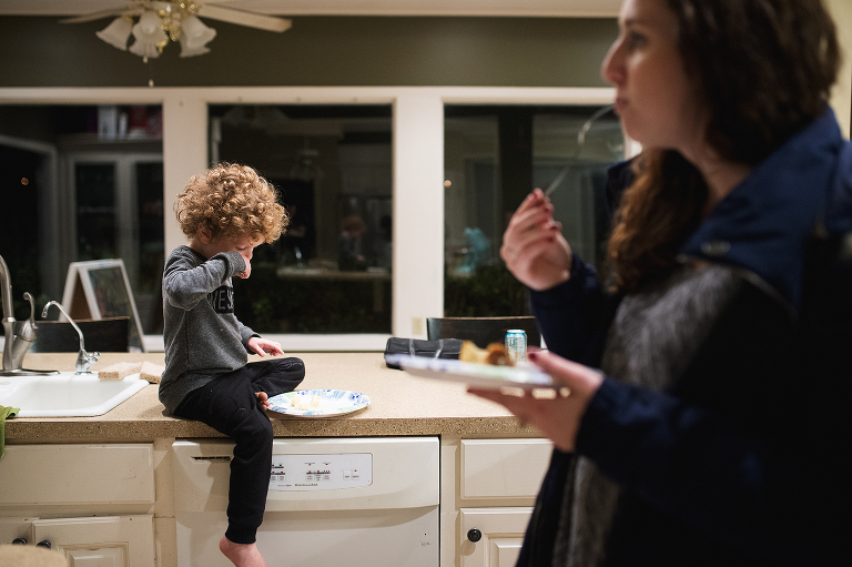 child eating on counter top - Documentary Family Photography