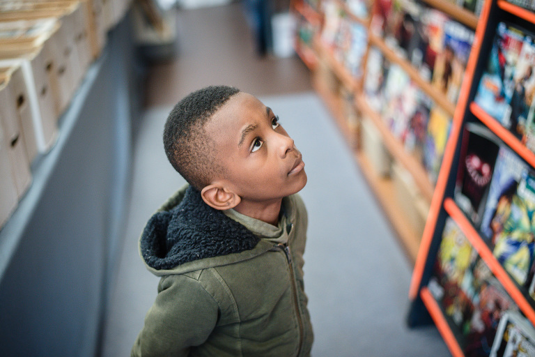 boy looking up at shelf - Documentary Family Photography