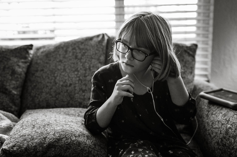 girl listening to ear buds - Documentary Family Photography