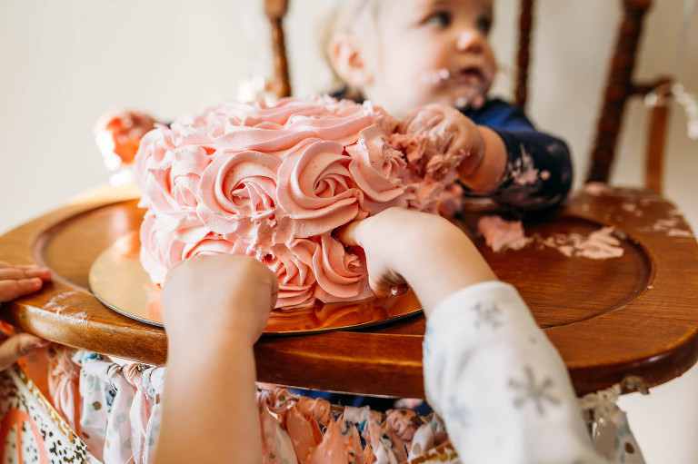 Kids with hands in cake - Documentary Family Photography