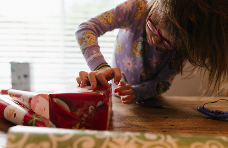girl wrapping gift - Documentary Family Photography