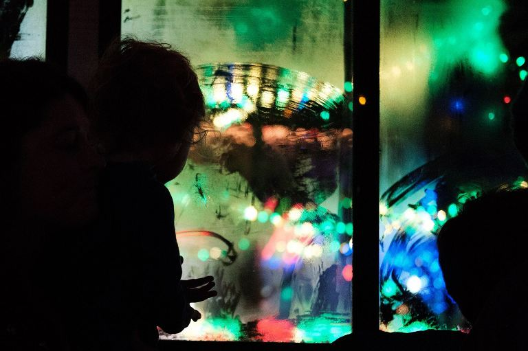 child silhouette at fogged window - Documentary Family Photography