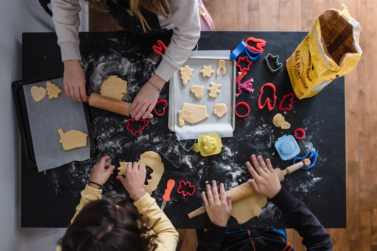 overhead shot of kids making cookies - Documentary Family Photography