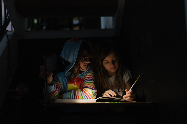 kids reading in the dark - Documentary Family Photography